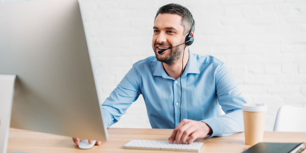 Cold Calling Tips and Techniques Salesperson with headset in front of computer